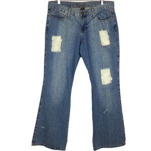 Grunge hippie chic deconstructed denim jeans
